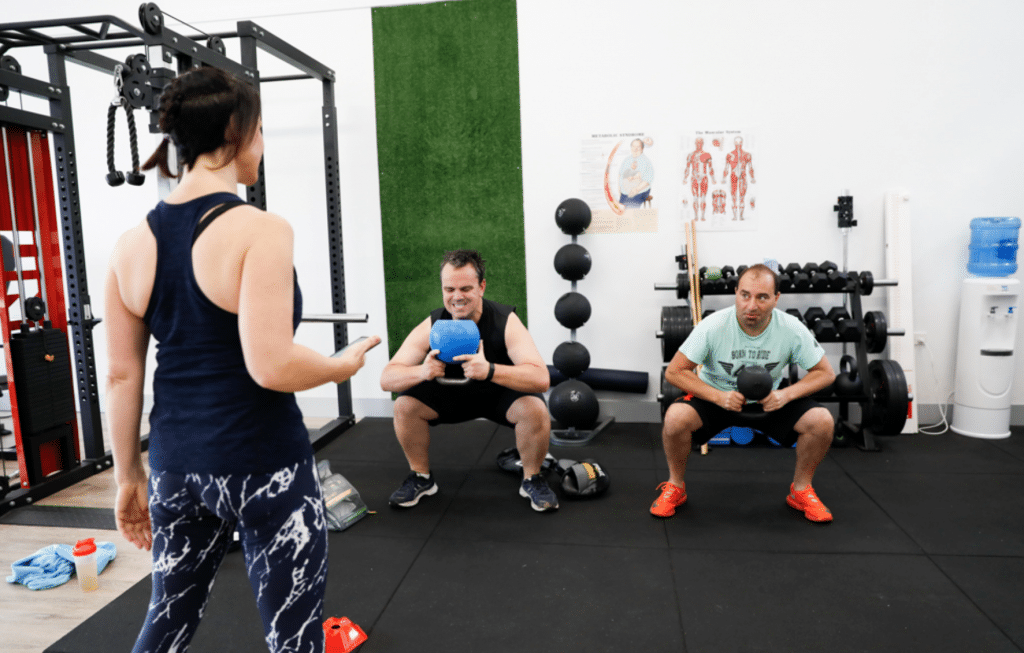 men in fitness class with trainer
