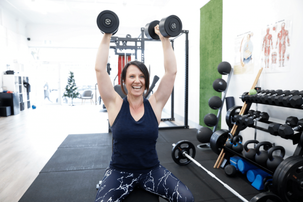 woman using weights to exercise