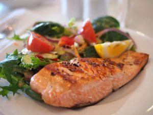 salmon with a salad on a plate