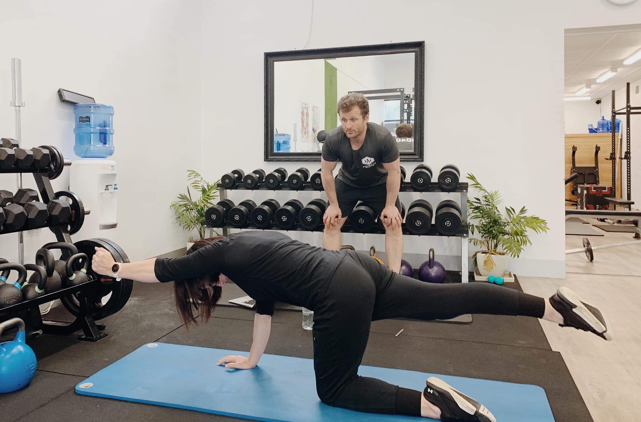 woman performing exercise at authentic health