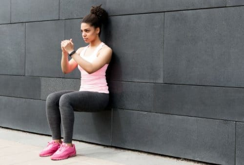 Woman does wall sit