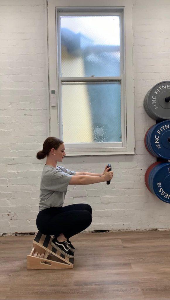 Woman does Counter Balance Squat