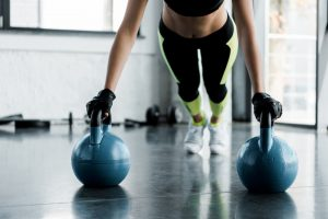 woman exercising with kettle bell